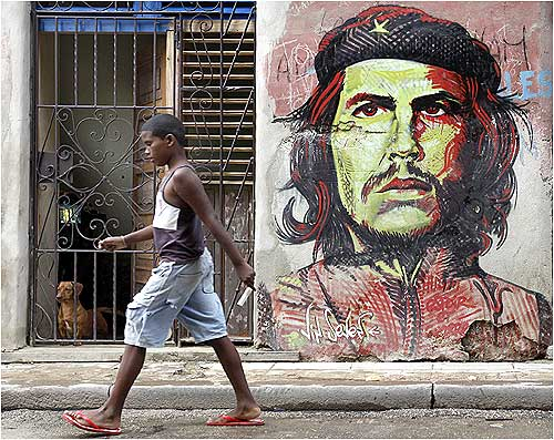 A boy walks on a street in Havana.