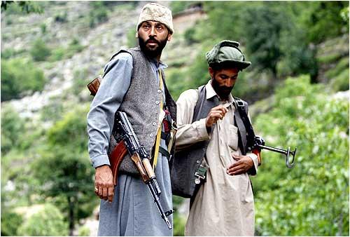 Lashkar members guarding a road pose for media in Swat