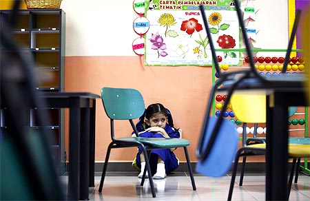 Preschooler Aleeya Amran, 6, refuses to attend class during her first day of school