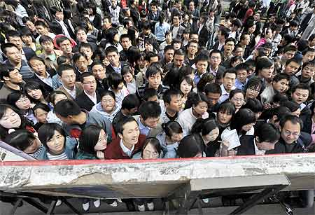 Graduates crowd outside a job fair held in Lanzhou in Gansu province