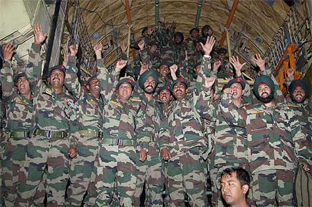 Indian army personnel gesture after their return from the first-ever joint military exercise between India and China in December 2007