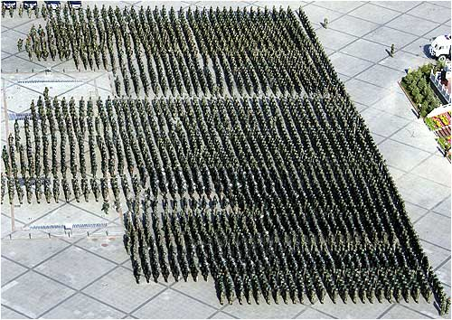 Chinese soldiers stand in formation