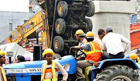 The toppled crane at the Delhi Metro mishap site