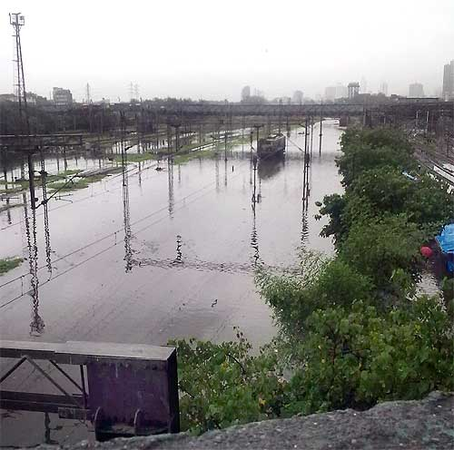 A view of the flooded Wadala railway station on Tuesday morning