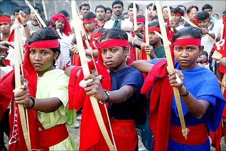 Women Naxalite cadre with bows and arrows during a rally in Kolkata