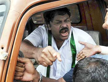 Chiranjeevi exhorts his supporters even as he is taken away from the venue in a vehicle