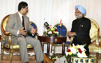 Pakistan Prime Minister Yousaf Raza Gilani interacts with Dr Singh