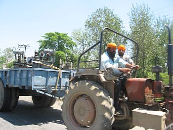 A farmer taking a transformer from Amritsar to his village