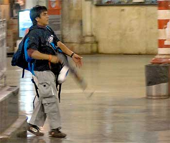 Pakistani terrorist Ajmal Kasab firing at people at Mumbai's Chhatrapati Shivaji Terminus