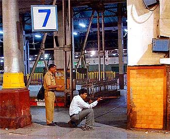 Inspector Ambadas Pawar fires at the terrorists at the Chhatrapati Shivaji Terminus during 26/11