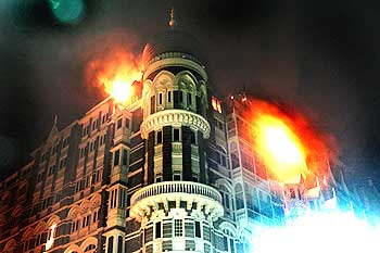 The Taj Mahal hotel is engulfed by flames during the operation to flush out the terrorists