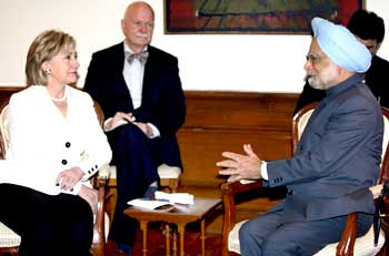 Prime Minister Manmohan Singh with US Secretary of State Hillary Clinton and US Charge d'Affaires in India Peter Burleigh during their meeting in New Delhi