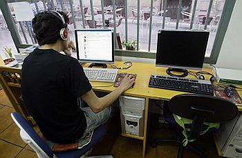 A man browses web at an Internet cafe in Madrid