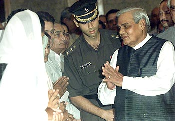 Former Prime Minister A B Vajpayee meets Kargil widows in New Delhi in July 2001