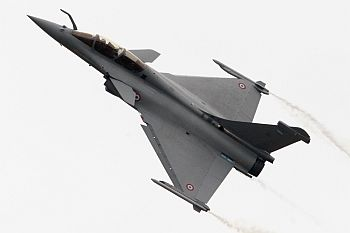A Dassault Rafale fighter jet takes part in a flying display during the 48th Paris Air S