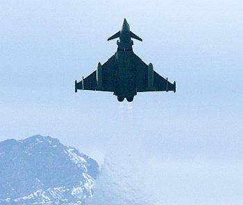 An EADS Eurofighter Typhoon jet takes off in front of the Mount Pilatus at the Swiss Army Airbase in Emmen, central Switzerland