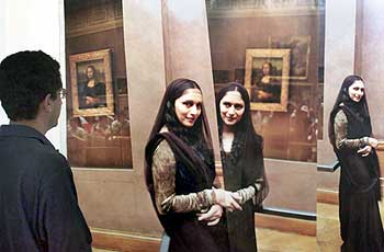 A visitor looks at a Husain collage of Madhuri Dixit at a Mumbai exhibition, December 4, 2000