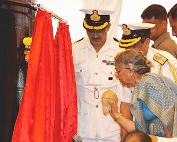 Gursharan Kaur, wife of Prime Minister Manmohan Singh breaking the auspicious coconut on the hull of the 6,000 tonne submarine, INS Arihant marking its launch