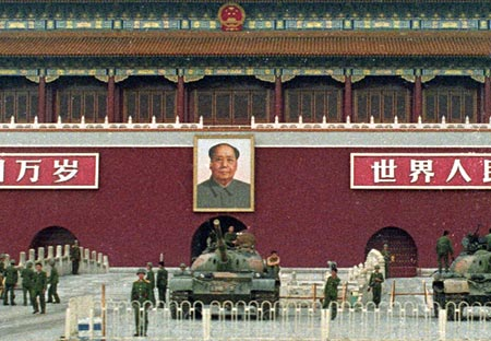 The Chinese People's Liberation Army guards the Gate of Heavenly Peace and Chairman's Mao portait in Tiananmen Square on June 9, 1989