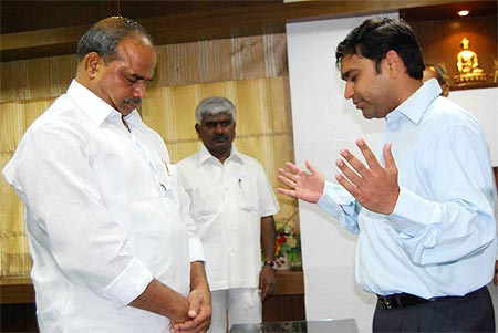 YSR with a pastor in his office