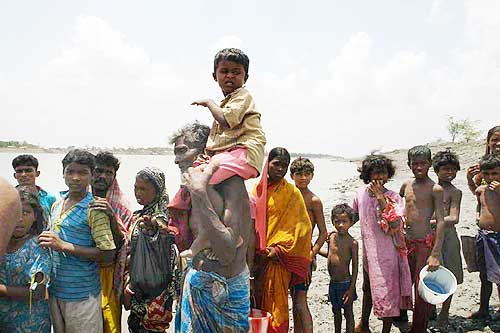 Villagers queue up for drinking water at Sarbaria in Sunderbans