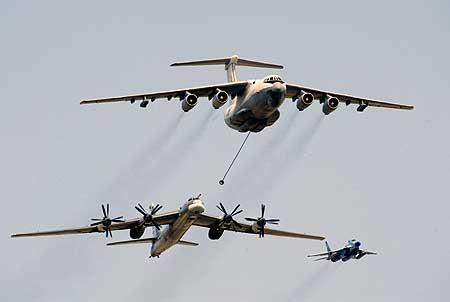 An Il-76 refueller extends the refuelling pod to a Russian TU-95 bomber