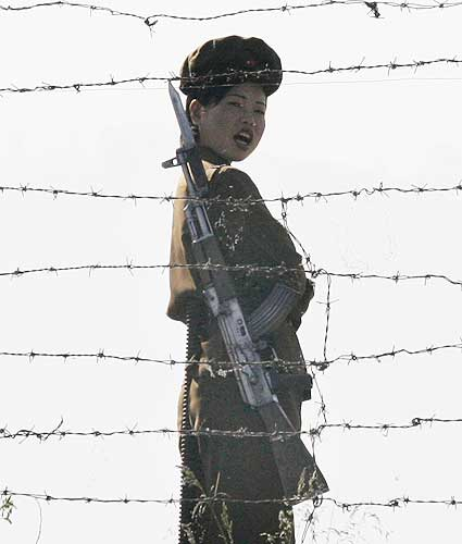 A North Korean soldier guards the banks of the Yalu River near the Chongsong county of North Korea  opposite the Chinese border town of Hekou