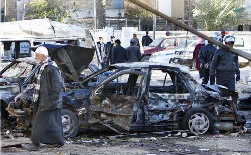 Destroyed vehicles after bomb attacks in Baghdad's Nahdha neighbourhood