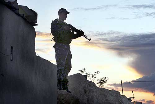 An Israeli security man stands guard near the West Bank