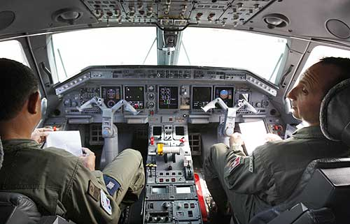 Brazilian Air Force team sit in the cabin of a R99 radar team, scoring fir clues.