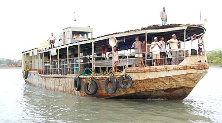A boat carrying food, water and medicines on its way to the Sunderbans