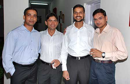 Singh, left, with Sandeep Unnikrishnan (2nd from right), who died in the attack, P V Manish (right)