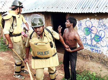 Police arrest a villager suspected to be a Maoist rebel