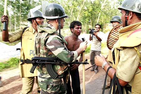 Police beat a villager suspected to be a Maoist rebel
