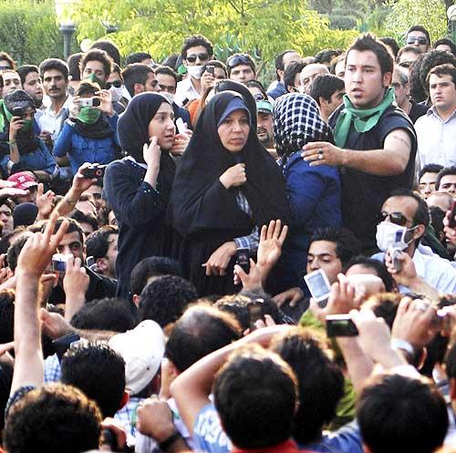 Faezeh Rafsanjani (C), daughter of former Iranian president Akbar Hashemi Rafsanjani, attends an opposition rally