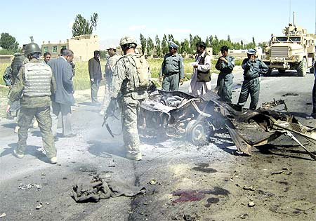 Security personnel at the scene of a suicide blast, Ghazni city, Pakistan, June 23, 2009.