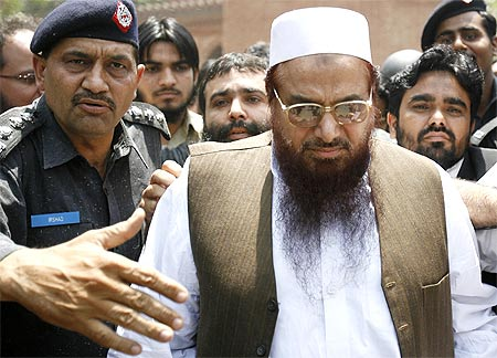 Police escort Lashkar-e-Taiba founder Hafiz Saeed, in Lahore, May 5, 2009.