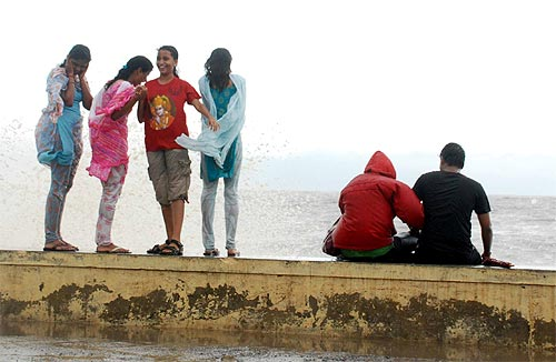Revellers enjoy the season's  first showers at Worli sea face