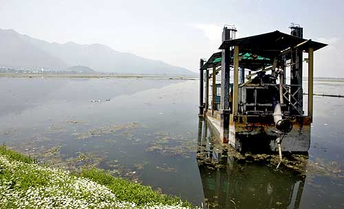 A view of a defunct weed removing machine inside the lake