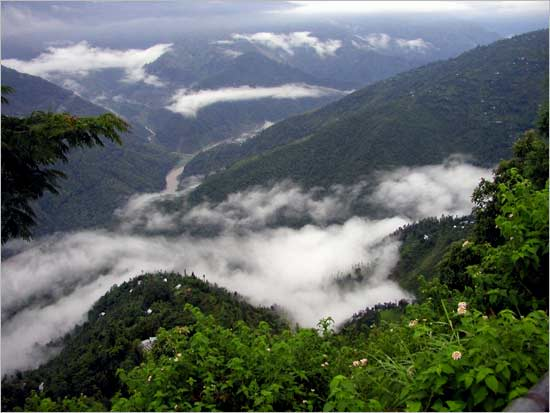 Monsoon clouds descending on green mountains of Kalimpong.