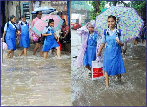 School children enjoying the rains.