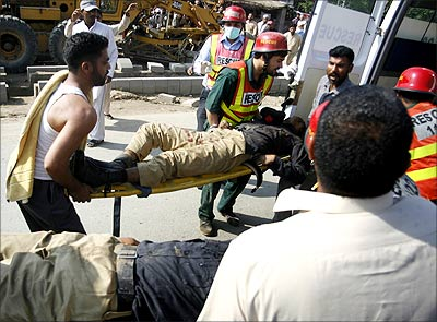 The scene after a terror attack in Pakistan, March 2009