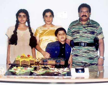 An undated photograph supplied by the Sri Lankan Ministry of Defence shows the Liberation Tigers of Tamil Eelam leader Vellupillai Prabhakaran standing with his wife Mathivathani, his son Balachandran and his daughter Duwaraka from a collection of photographs that government soldiers said they discovered recently in a hideout in northern Sri Lanka