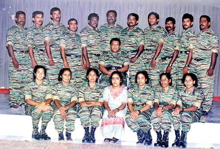 Prabhakaran (Centre) and his wife Mathivathani (front row, Centre) sitting with LTTE soldiers