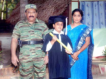 Prabhakaran with his son Balachandran and wife Mathivathani
