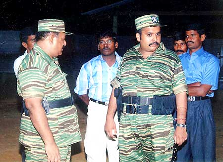 Prabhakaran (left) and his son Charles Anthony (second from right)