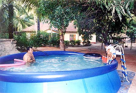 Prabhakaran swimming in a pool with his son Balachandran