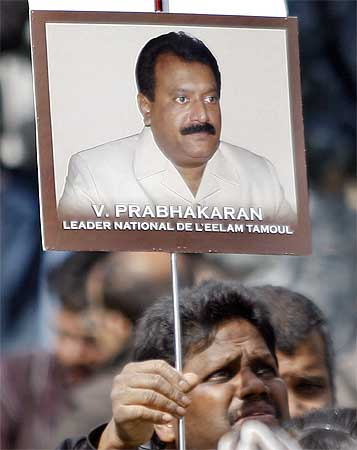 A protester waves a poster of LTTE leader Prabhakaran during a demonstration in support of the Tigers in Paris