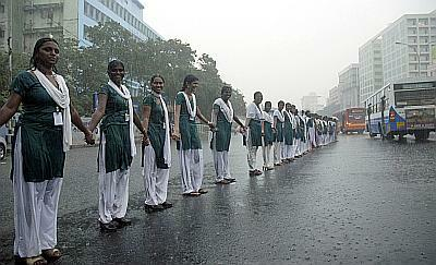 Schoolgirls form a human chain to protest against the conflict in Sri Lanka, in Chennai