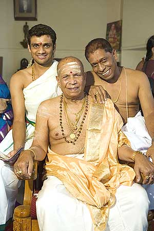Ashtanga yoga guru K.Pattabhi Jois with son Manju (right) and grandson Sharath Rangaswamy